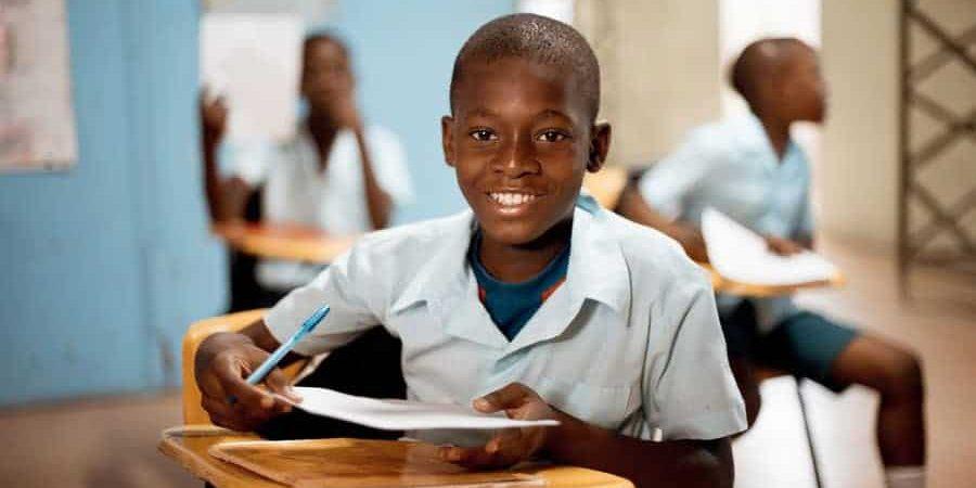 boy-holding-paper-school
