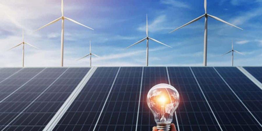 hand-holding-lightbulb-with-solar-panel-wind-turbine