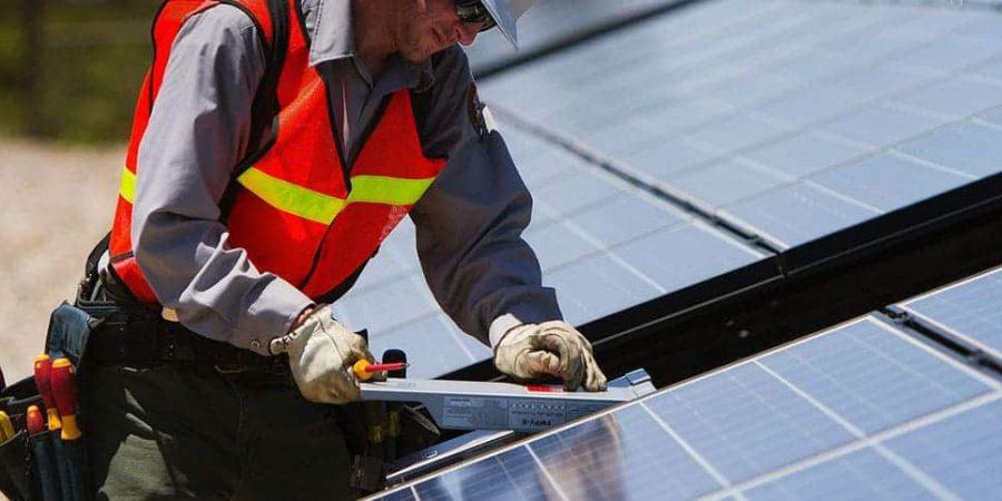 man-installing-solar-panel