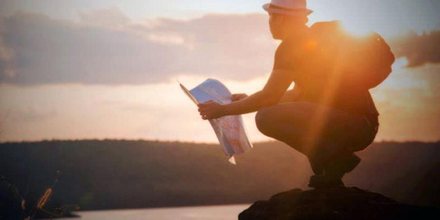 tourist-reading-map-sunset