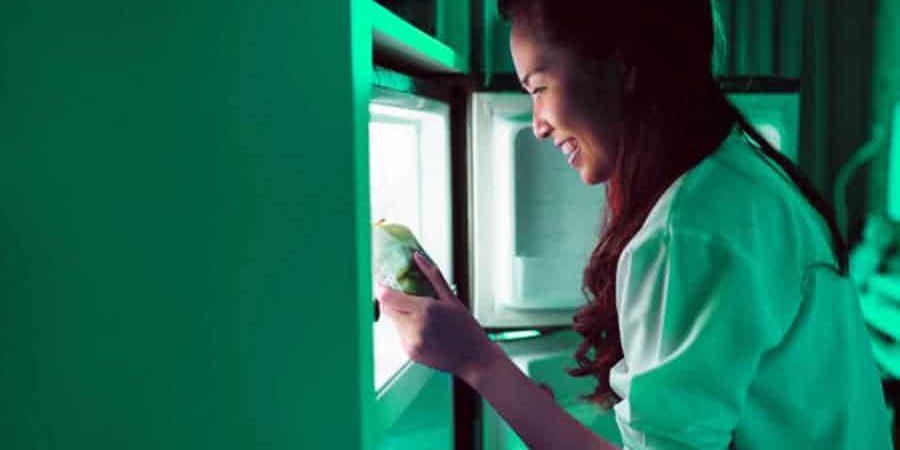 women-open-refrigerator